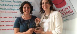 Kara Stanford winning her marketing award from the Watertight Marketer Bryony Thomas
