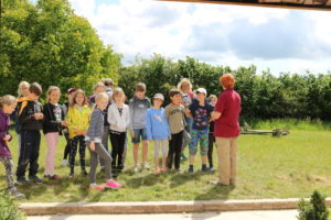 A group of school children visiting Butser Ancient Farm in spring