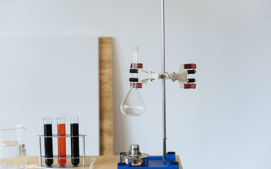 science equipment including test tubes, measuring flask, filtration stand